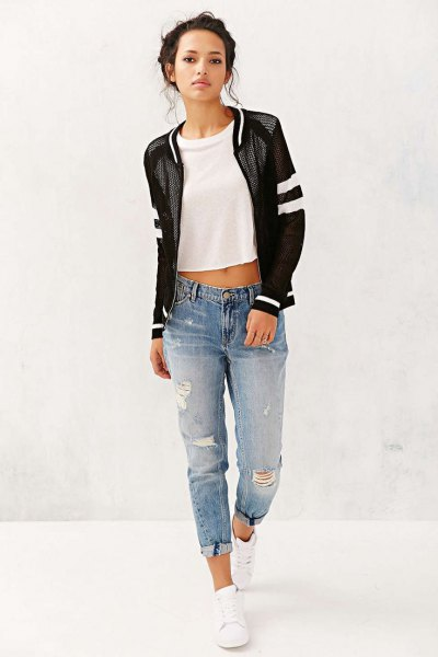 black fishnet jacket with short white T-shirt and boyfriend jeans