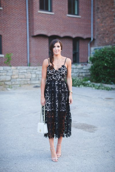 black lace dress with midi spaghetti straps and pale pink heels