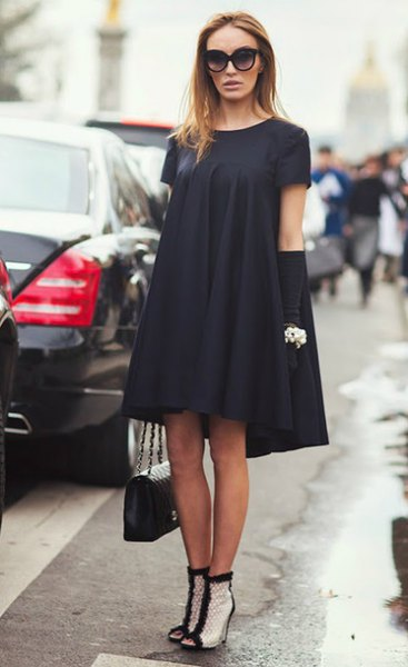 black midi swing dress with white ankle boots with ankle heel