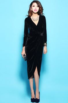 black midi velvet long-sleeved wrap dress with V-neckline and silver necklace