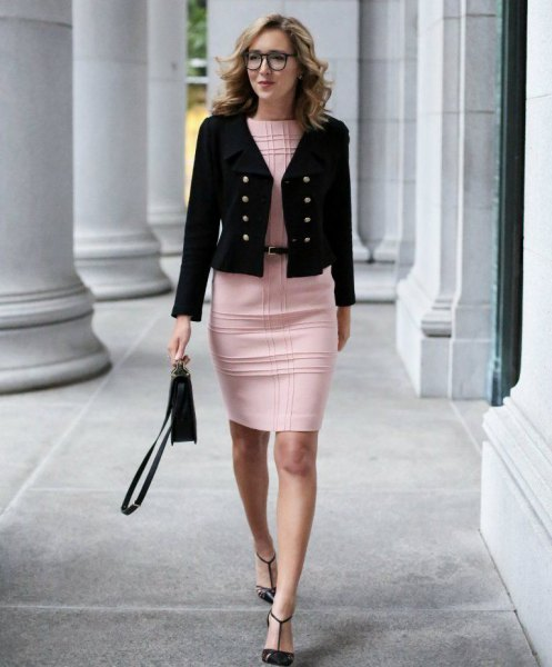 black, short-cut military blazer with a checked, figure-hugging mini dress in pink