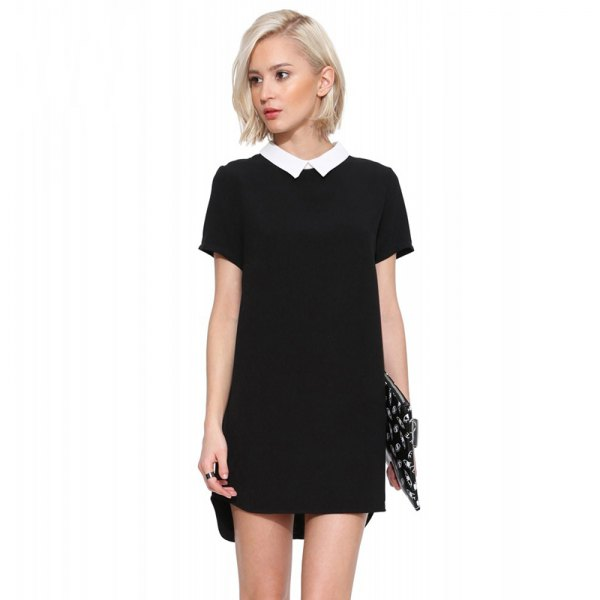 black mini dress with dotted sequin clutch
