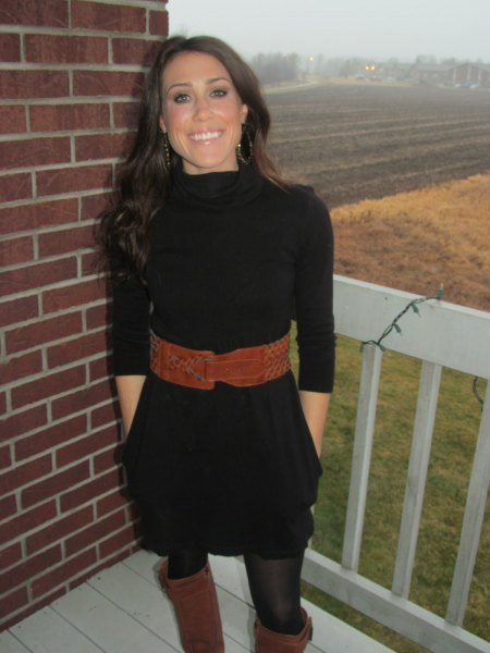 black mini sweater dress with half sleeves and a brown, wide belt