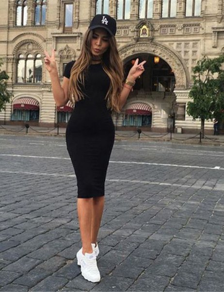 black mini short-sleeved dress with baseball cap and sneakers