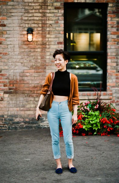 black mock neck crop top with light green cardigan and mom jeans