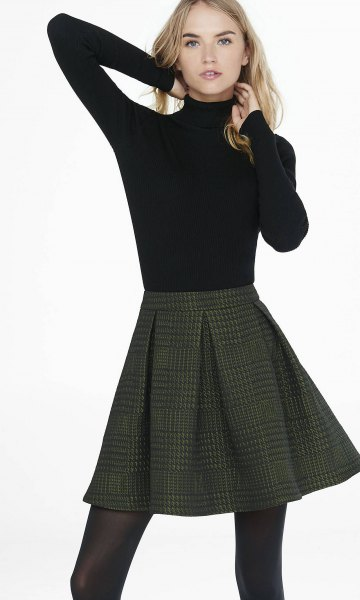 black sweater with stand-up collar and dark red checked mini skirt