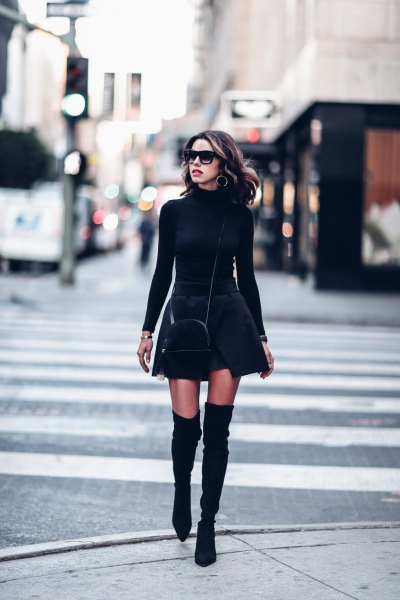 black, figure-hugging sweater with stand-up collar and minirater skirt