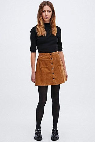 black mock-neck sweater with half sleeves and brown corduroy mini skirt with button placket