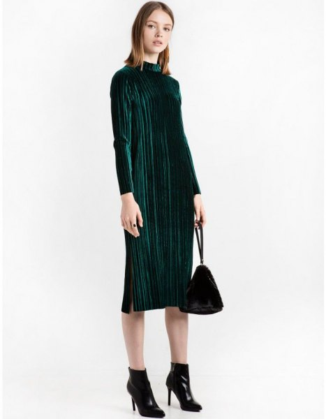 black midi pleated dress with stand-up collar and ankle boots