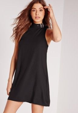 black mini dress with stand-up collar and matching heels with open toes