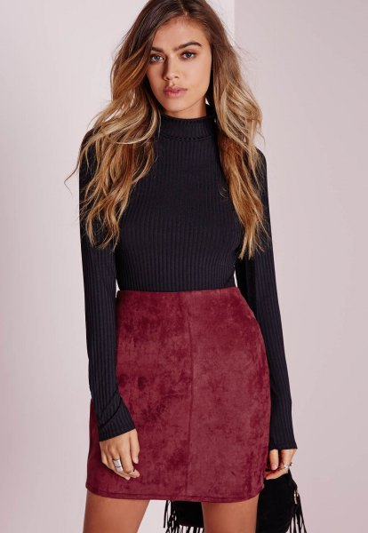 black, ribbed, figure-hugging sweater with mock neck and mini skirt made of burgundy red suede