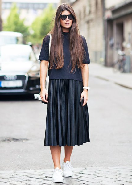 black short-sleeved sweater with stand-up collar and pleated midi skirt