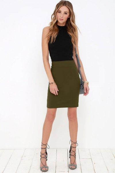 sleeveless, figure-hugging top with black stand-up collar and olive green mini skirt