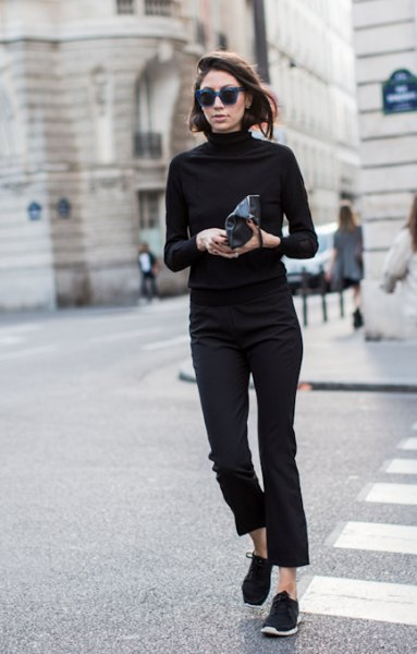 black mock neck sweater with cropped slim fit jeans and hiking boots