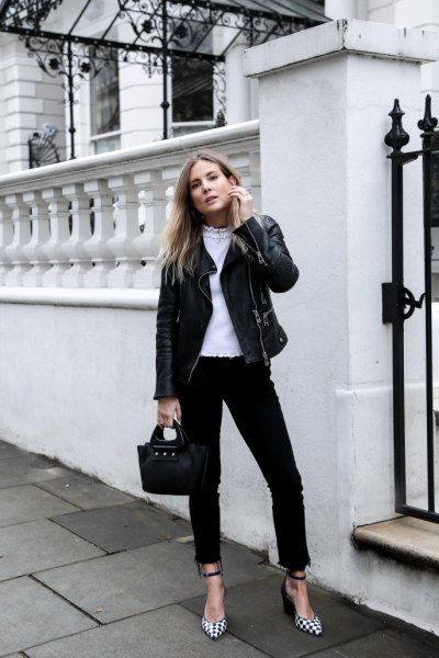 black moto jacket with high-rise jeans and checked heels