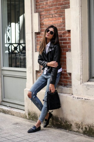 black moto jacket with gray, heavily torn jeans and leather loafers