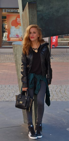 black moto jacket with gray leggings and hidden wedge sneakers with high top