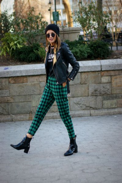 black moto jacket with knitted hat and green, checked, cropped pants