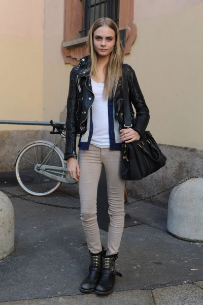 black moto jacket with light gray skinny jeans and motorcycle ankle boots made of leather