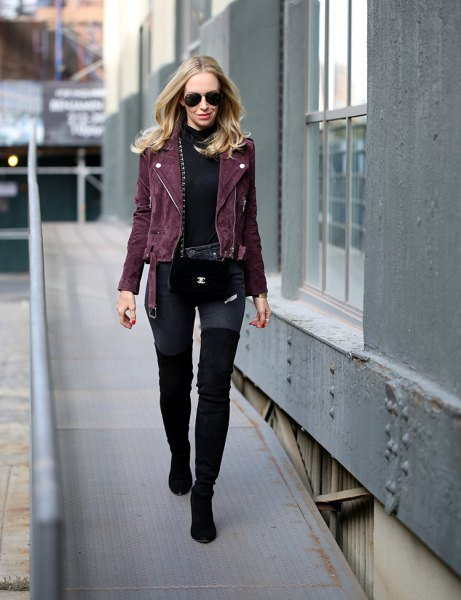 black moto jacket with mock neck sweater and overknee boots