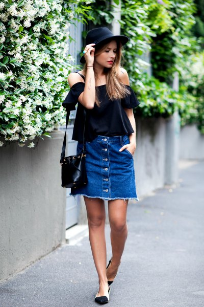 black off-the-shoulder blouse with denim mini skirt with button placket