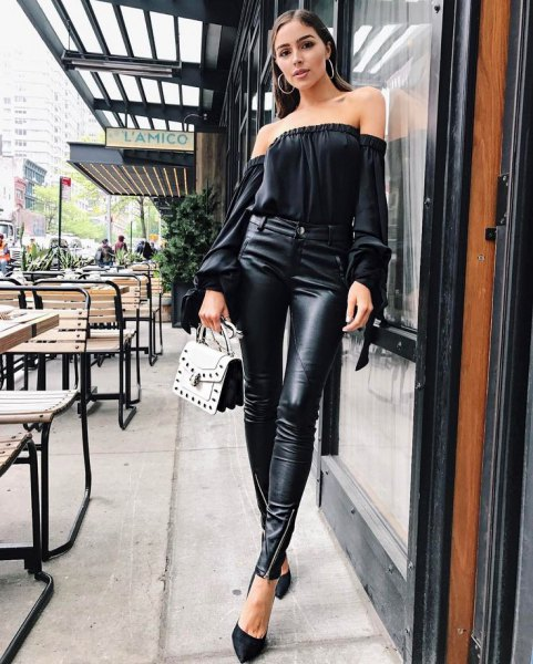 black strapless blouse with high leather gaiters