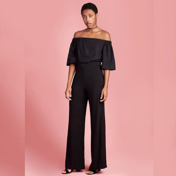 black off-the-shoulder blouse with high pants with wide legs