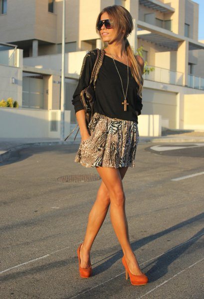 black off-the-shoulder blouse with printed minirater skirt and orange heels