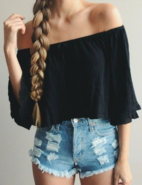 Black off shoulder shirt with half sleeves and blue shorts with mini denim tear