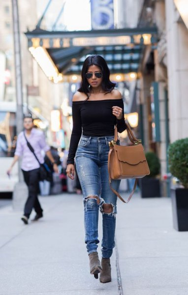 Off-the-shoulder, long-sleeved, elegant top with torn, narrow-cut jeans