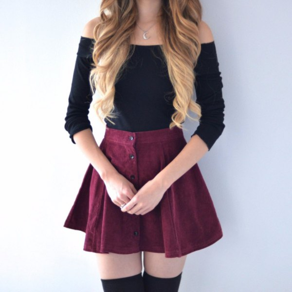 black strapless sweater with skater mini skirt with button placket