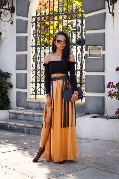 Black strapless top and gold maxi skirt