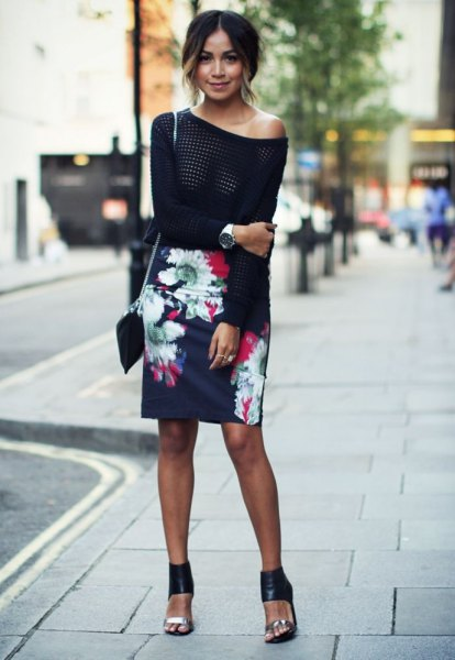 black knitted sweater with one shoulder and dark blue pencil skirt with a floral pattern