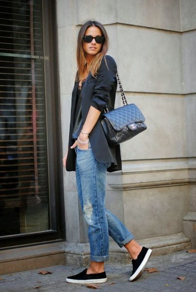 black oversized blazer with gray t-shirt with scoop neckline and jeans with cuffs