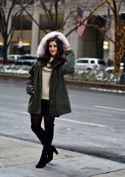 black oversized coat with ivory-colored sweater with round neckline