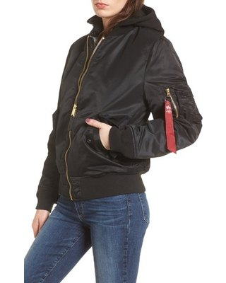 black oversized bomber jacket with hood and dark blue slim fit jeans