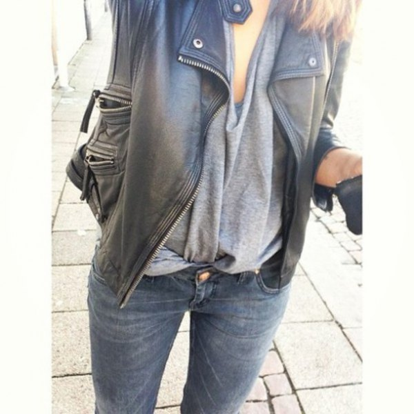black oversized leather jacket with gray draped top and slim fit jeans