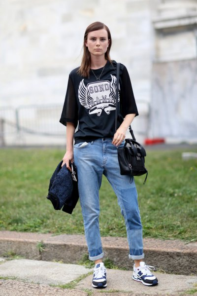 black oversize print t-shirt with relaxed blue jeans with cuffs