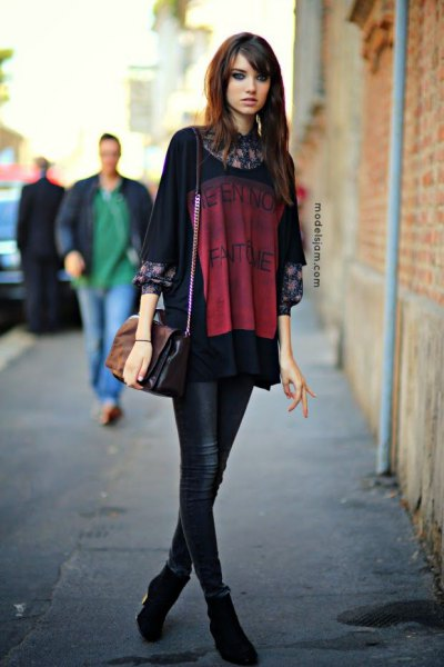 black oversized t-shirt over floral blouse