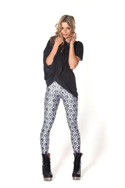black oversized t-shirt with floral leggings and leather boots