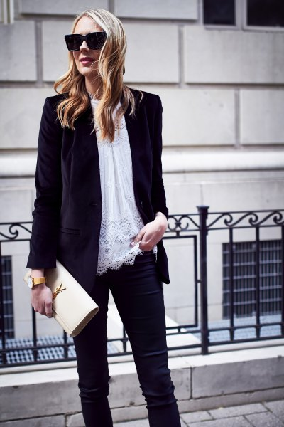 black oversized velvet jacket with white tunic top made of lace and slim-fitting jeans