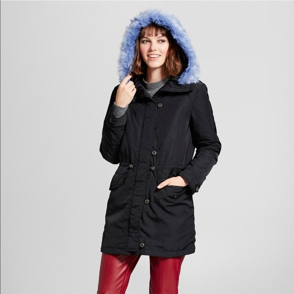 black parka jacket with blue hood and brown leather pants