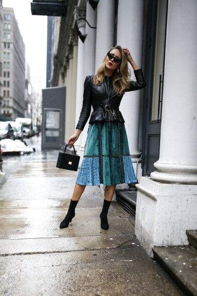 black peplum leather jacket with blue midi skirt