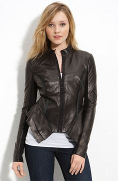 black peplum leather jacket with white vest top and skinny jeans