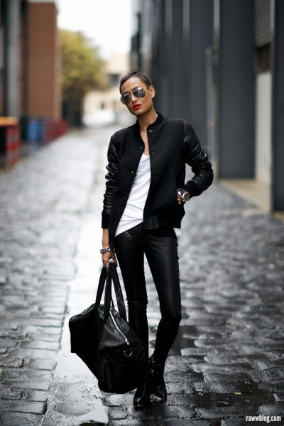 black pilot jacket with white tank top and leather boots