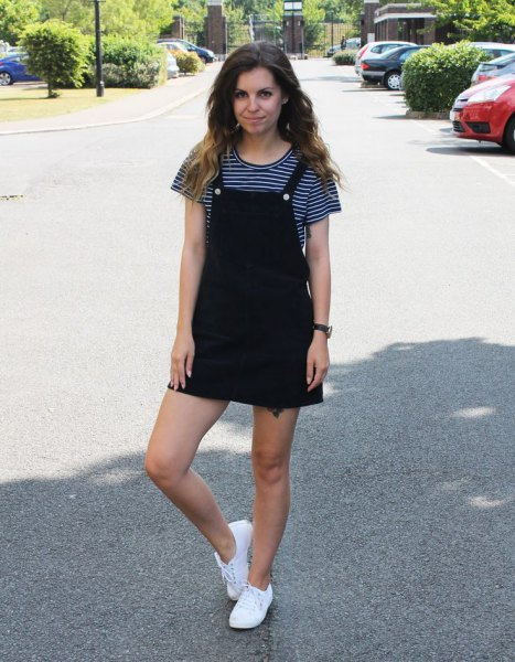 black pinafore dress black and white striped t-shirt