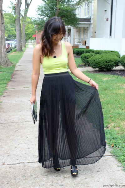 black pleated maxi skirt yellow tank top