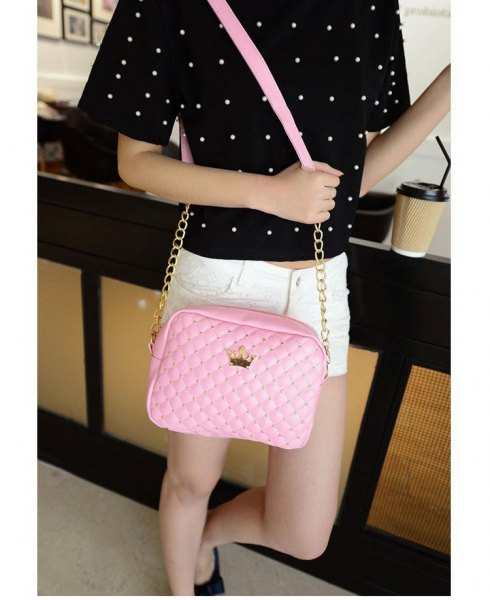 black polka dot t-shirt with white mini denim shorts and blushing leather shoulder bag