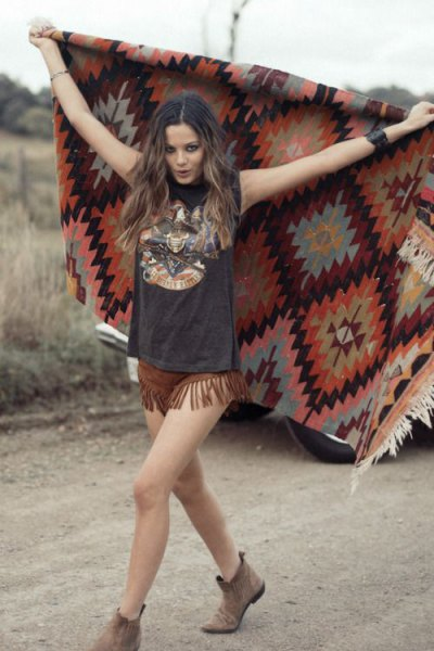 black printed t-shirt brown suede shorts with fringes
