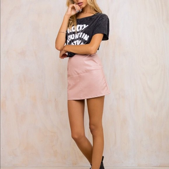 black printed t-shirt with high waisted pink leather skirt